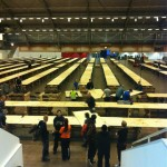 View from the escalators at Hall D, most of the tables already built.